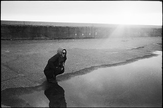 kneeling by a big puddle | by gorbot.
