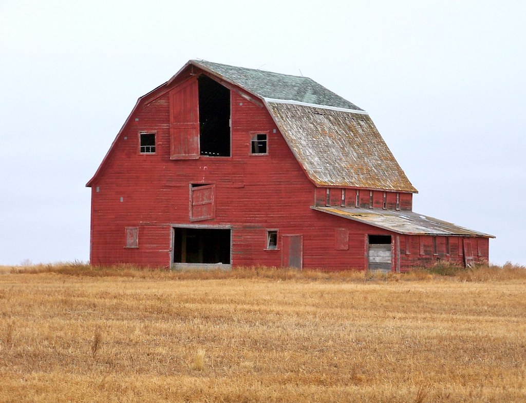 Sk11j03 red hip roof barn in rm harris saskatchewan flickr for Hip roof barns