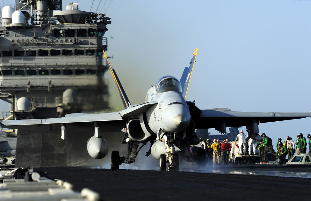 An F/A-18C Hornet launches from the Nimitz class aircraft carrier USS John C. Stennis (CVN 74)