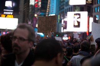 A protester holds a sign   in Times Square | by TenSafeFrogs