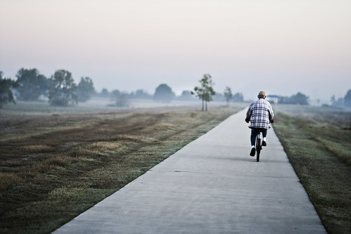 The Lonely Cyclist | by Andre Woodard