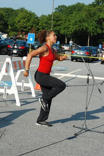 Fitness instructor leading a warm up for the event | by CDC Social Media