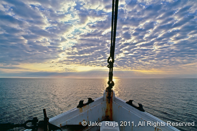Bow of fishing boat at dawn long island sound new york for Long island sound fishing report