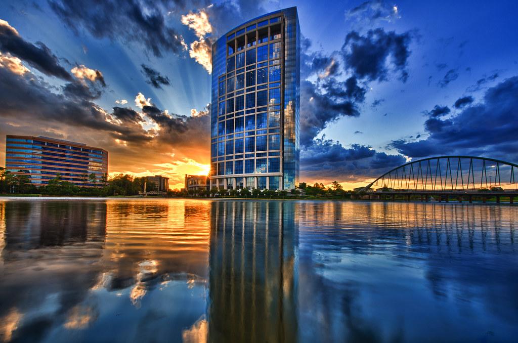 anadarko tower reflected in lake robbins tonights