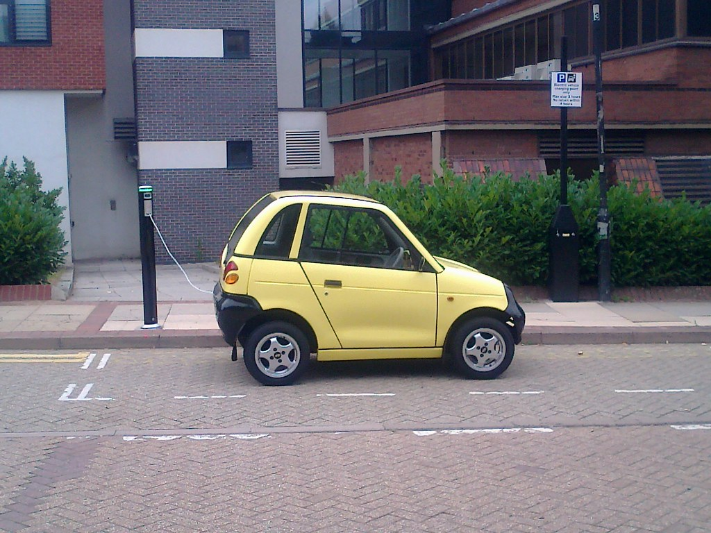 G Whizz Electric Yellow Car Charging On Aston Street