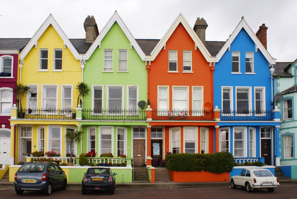 Brightly Painted Houses Along The Shorefront At Whitehead