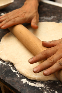 rolling pizza dough | by David Lebovitz
