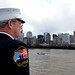 New York Fire Department chief prepares to present honors as they pass the World Trade Center and the National September 11 Memorial aboard USS New York