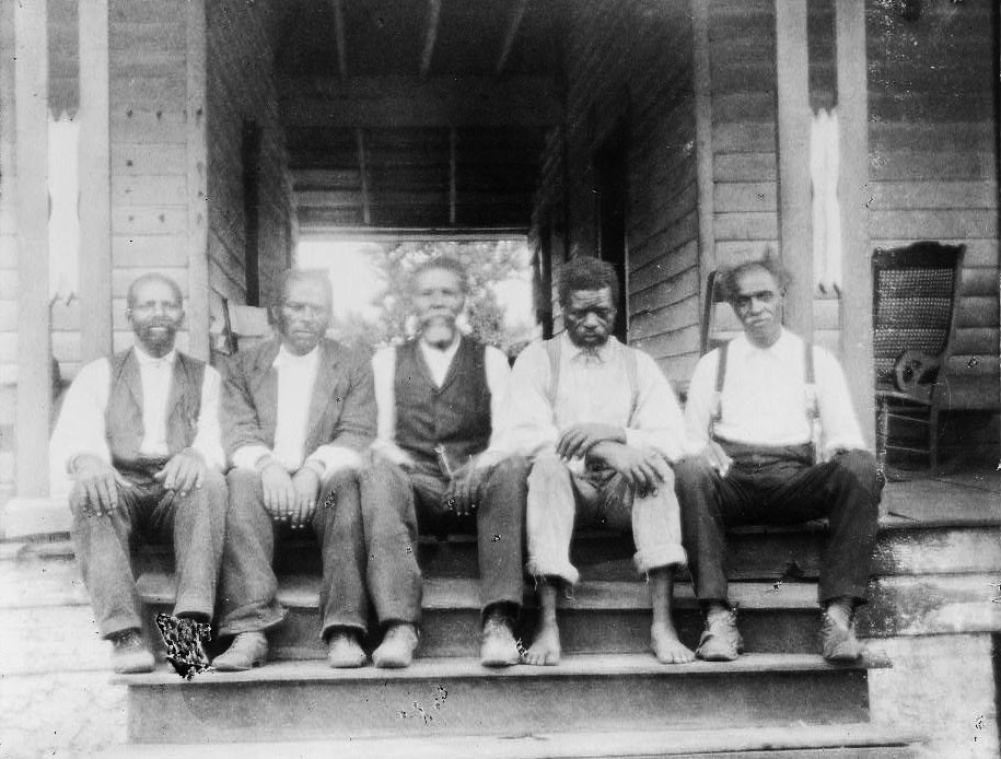 African American Men Seated On Porch Steps In Georgia 18