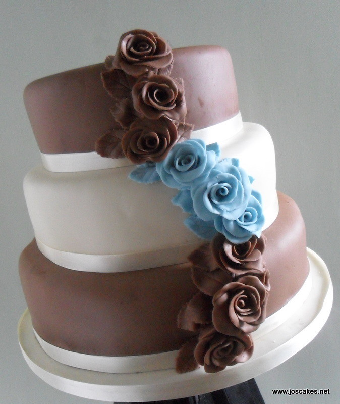 wedding cake with blue roses w046 chocolate and baby blue roses wedding cake 3 26830