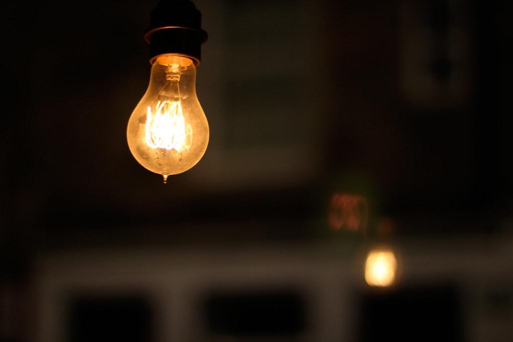 ... Hanging orange filament light bulb | by artylondon