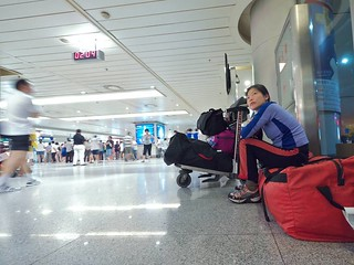 DEA36268 Szu-ting waiting at 2am in the Chengdu airport  for Erics flight to arrive | by Planet Granite