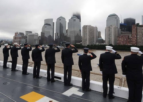 Members of the Fire Department of the City of New York present honors as they pass the World Trade Center and the National September 11 Memorial aboard USS New York | by Official U.S. Navy Imagery