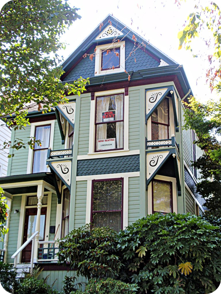 Green queen anne victorian house front view north Victorian house front