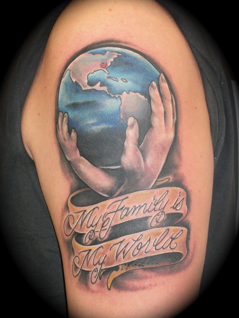 My family is my world this tattoo was done on the band for My family tattoo