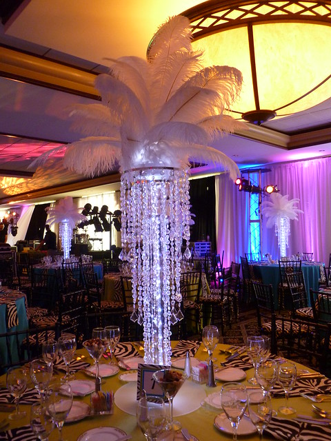 Chandelier centerpieces with feather tops and led lights