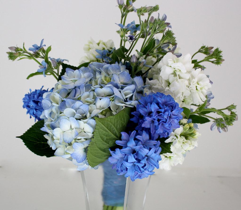 Blue tweedia and hyacinth bouquet designed by brenda