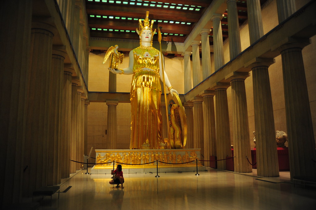 Athena Parthenos Ancient Greek Ἀθηνᾶ Παρθένος literally Athena the Virgin is a lost massive chryselephantine gold and ivory sculpture of the Greek goddess Athena made by Phidias and his assistants and housed in the Parthenon in AthensDespite the dynamic architectural characteristics of the Parthenon the statue of Athena was designed to be the focal point
