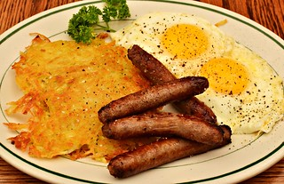 Mmm... Breakfast - hash browns fried in olive oil, butter basted eggs, sausage links. | by jeffreyw