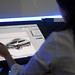An unidentified artist showcases a digital sketching of a concept car