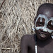 portrait of the child mursi tribe with the face painting