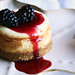 citrus cheesecake with blackberry sauce