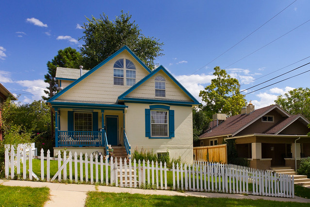 Blue Trim Victorian House With White Picket Fence