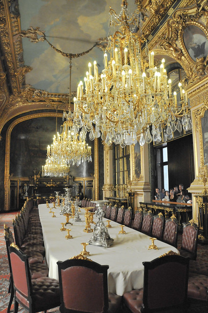 french royal palace dining room and chandeliersat louvre