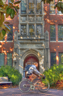 365@VU: 296 - A student rides her back past the entrance to Buttrick Hall. | by Vanderbilt University