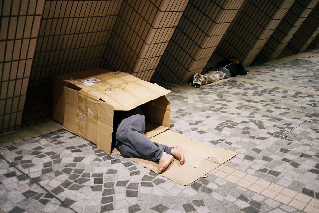 Homeless Sleeping Outside The Hong Kong Cultural Centre