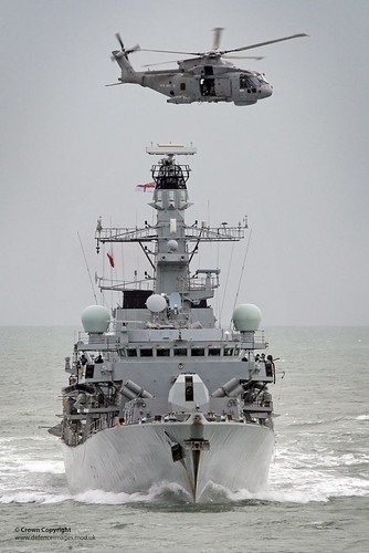 Royal Navy Type 23 Frigate HMS Sutherland with a Merlin Helicopter Overhead | by Defence Images
