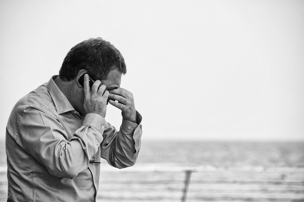 Worried man on cellphone