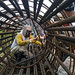 Man working inside a large reinforced steel tube