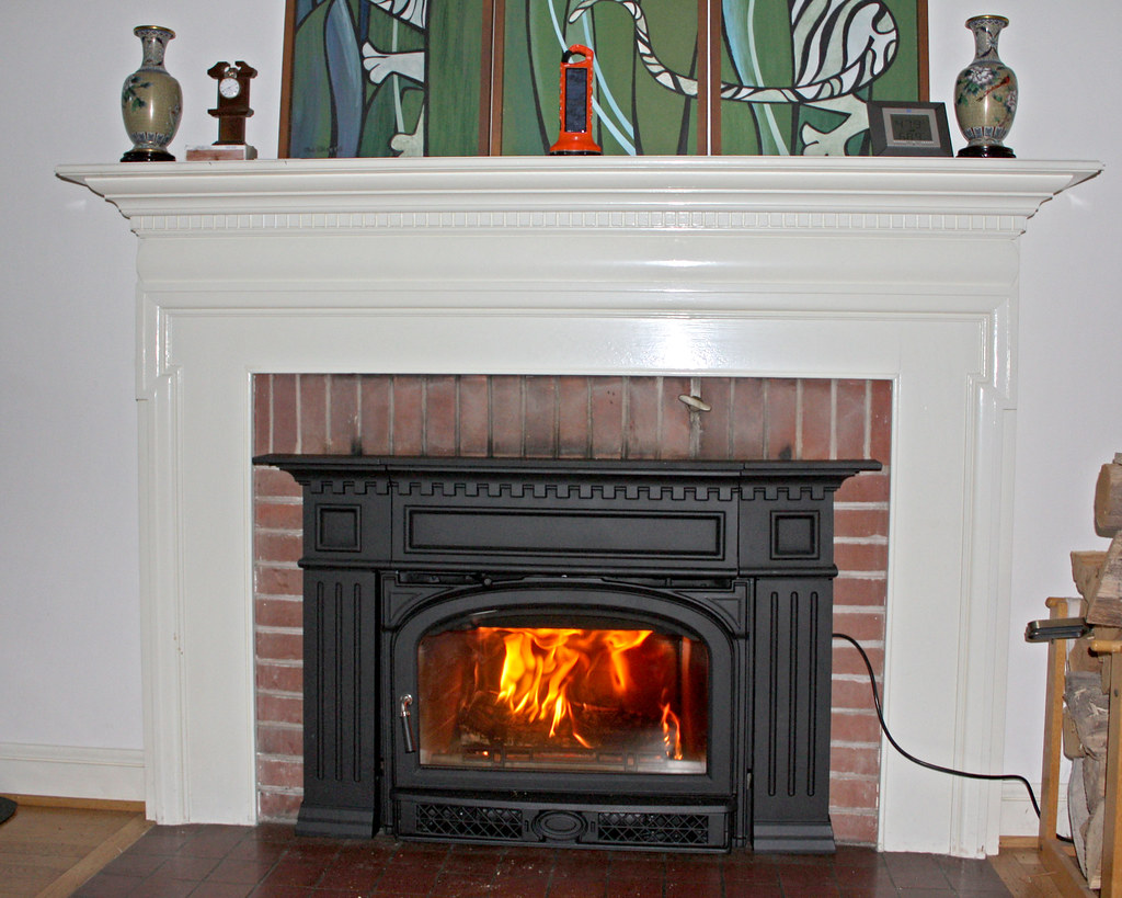 Fireplace inserts have become more and more efficient over the years.  Recently this Vermont Castings Montpelier fireplace insert with a Georgian surround was installed in our home.  This is a medium sized insert that can heat anywhere between 1500 and 1800 square feet