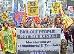 April 3, 2009 demonstration on Wall Street calling for a complete bailout of the people, not the banks. The demonstration was organized by the Bailout the People Movement (BOPM). | by Pan-African News Wire File Photos