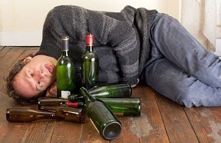 4775021-drunk-man-lying-on-floor-with-empty-bottles | by RedCrake