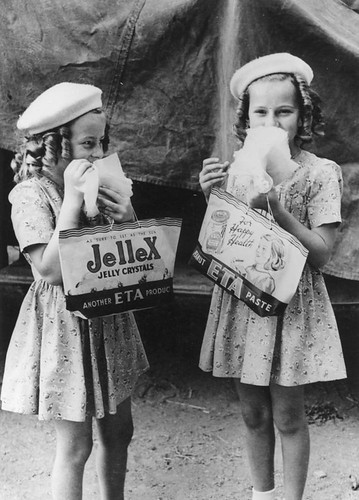 Two young girls enjoying themselves at the RNA Show, Brisbane, 1946 | by State Library of Queensland, Australia
