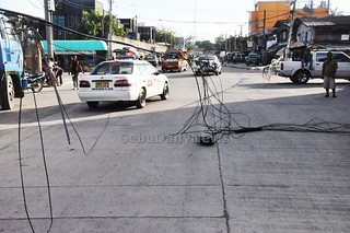 Which utility firm owns this jumble of wires that have fallen on Arellano Street near Pier 2 in Cebu City? They need to be fixed soon. | by Siloy Is Watching