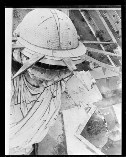 New York steeplejack doing his stuff on top of the Statue of Liberty | by Boston Public Library