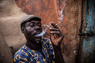 man who smokes of the people Gurunsi, south of Burkina Faso | by anthony pappone photography