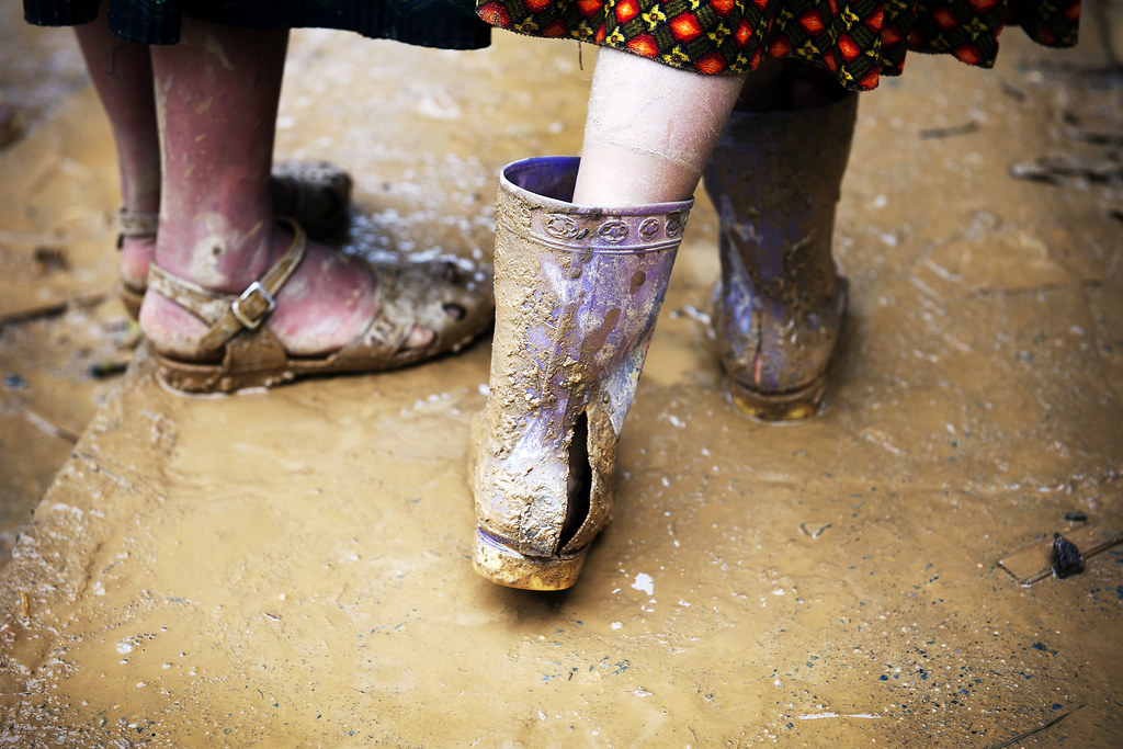 Poverty In Viet Nam A Teenager Wears Torn Rubber Boots