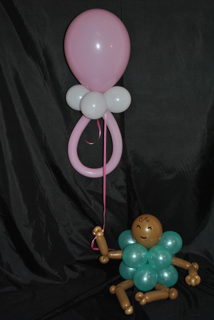 Baby holding pacifier balloon centerpiece deliza nieves