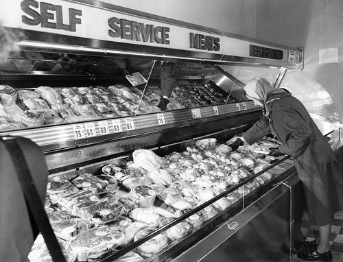 People serving themselves at the Berg's Supermarket meat section, circa 1950 | by OSU Special Collections & Archives : Commons