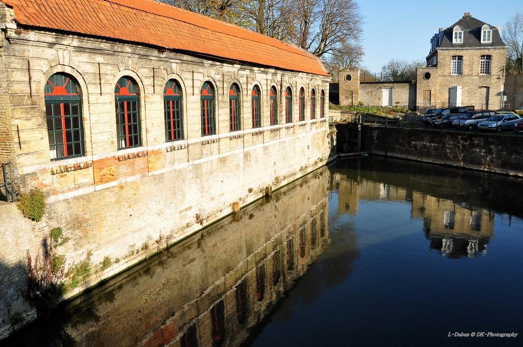 """L'ancien abattoir de Bergues - un des lieux du film """" Bienvenue chez les ch'tis """" réalisé par Dany Boon - France . reflect reflecting refleted reflection reflet"""