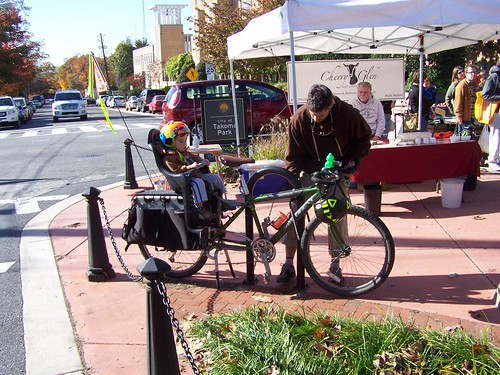 Parent and child on a bicycle, Takoma Park Farmers Market