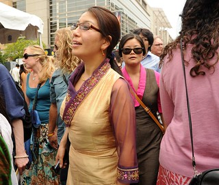 Tibetan woman make their way through the crowd, Contemporary Tibetan Chuba design of gold silk, fancy detail on collar and cuffs, coral earrings, Kalachakra for World Peace, Happy Birthday to the Dalai Lama Parade, Washington D.C., USA | by Wonderlane