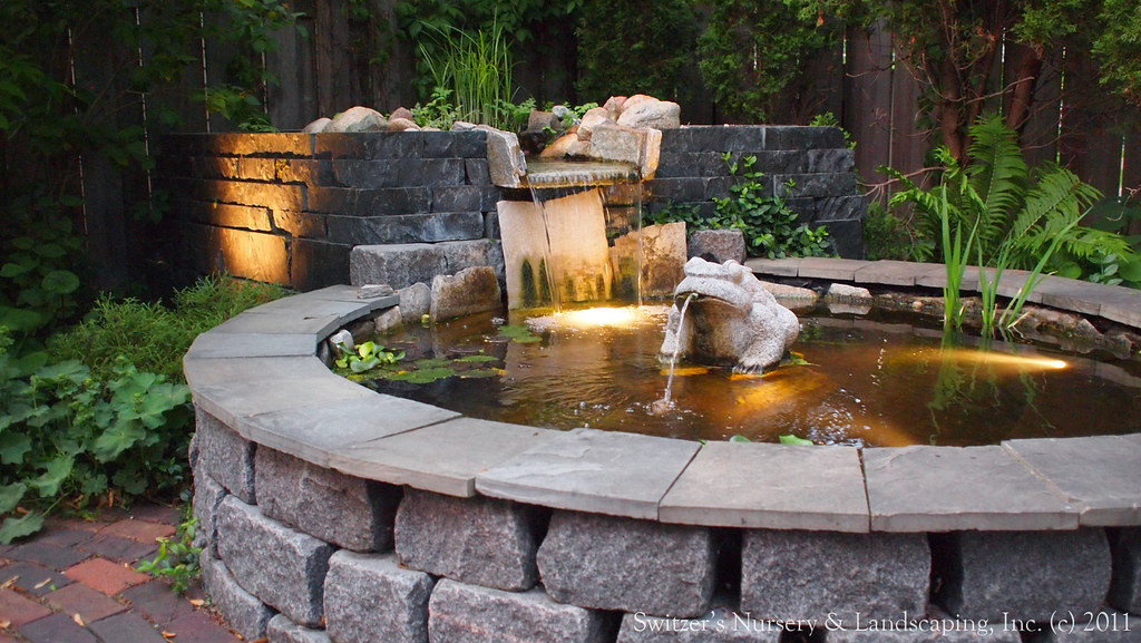 Minnesota landscape design inspired by bali natural ston for Contemporary koi pond design