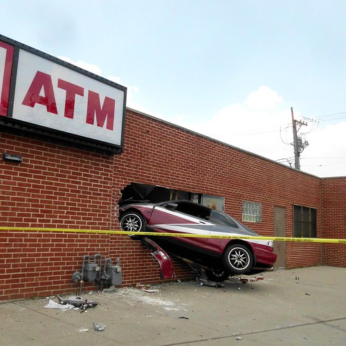 car stuck in a building, North & Kedzie, Chicago | by katherine of chicago