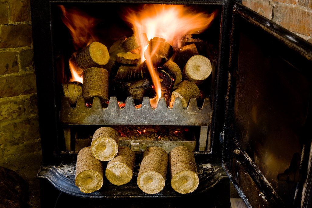 Compressed Wood Logs ~ Compressed wood chip and sawdust pellets burning in a hous