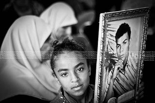Palestinians march and hold pictures of imprisoned relatives at rally | by M.Hassona